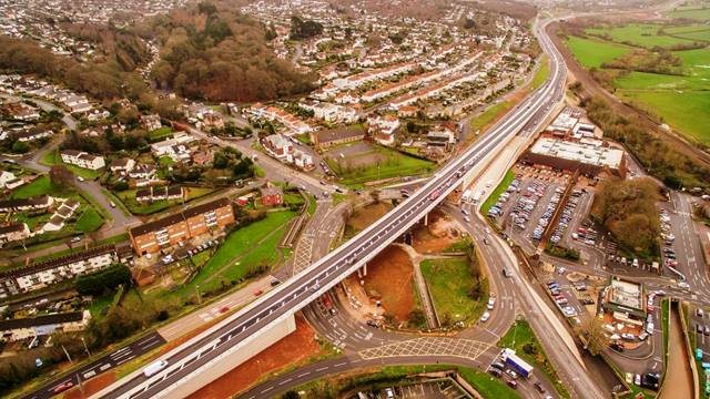 Skyflicks Media. The Penn Inn Flyover relieves heavy congestion by carrying the South Devon Link Road over the roundabout. [Aerial photography - please contact for permission/cost of use: matt@skyflicksmedia.com, tel: 07921 850626]