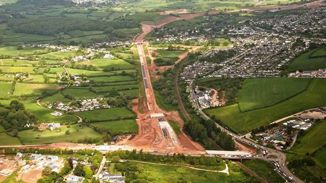 Devon County Council. Arial view of the scheme looking North showing how the southern end connects to the Torbay ringroad. The new road follows the Torbay branch line with the existing A380 and villiage of Kingskerswell to the East. [Photography by Tim Pestridge]