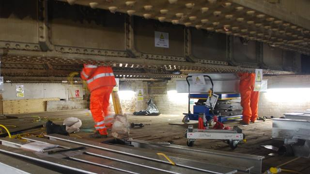 Ramboll. Engineers working on original ticket hall structures, Bermondsey Dive Under, London, UK.