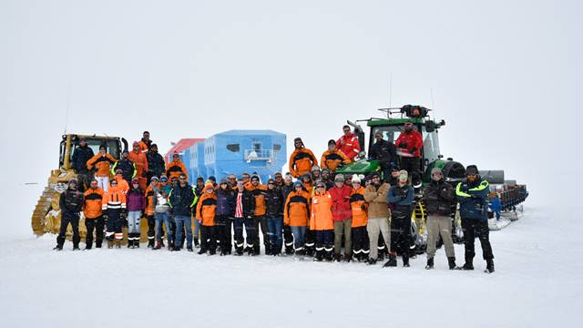 Image: British Antarctic Survey. The Halley VI relocation team takes a break at Christmas 2016