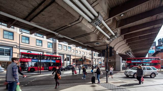Daniel Shearing. The completed strengthening work on the underside of the Hammersmith Flyover as seen by pedestrians and traffic passing below