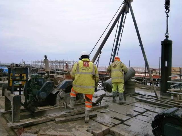 Ramboll. The piling tripod assisted by a small crane
