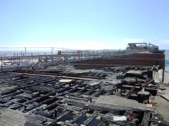 Ramboll. Burnt deck timbers of Hastings Pier after the devastating fire in 2010