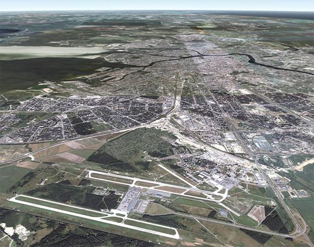 Aerial View of Existing Airport in Context with the City