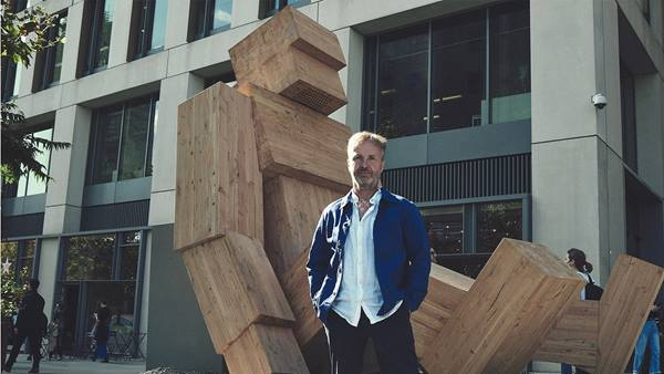 Designer Steuart Padwick in front of one of the 'Talk To Me' sculptures © Tim Cole