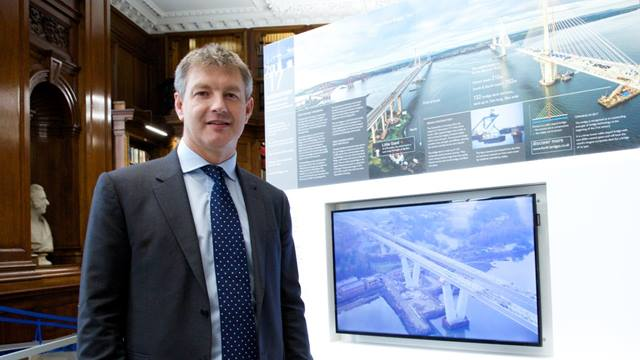 Dan Harvey, Ramboll Executive Director at the ICE Infrastructure Learning Hub, in front of the Queensferry Crossing exhibit.