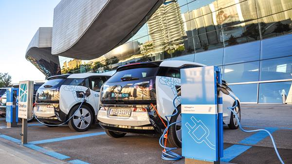 Electric cars being charged at a charging station