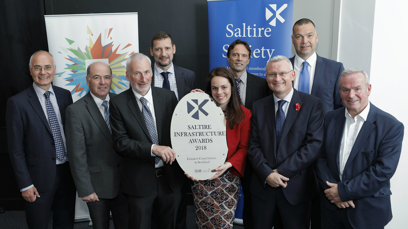 Peter Curran (far right) along with Transport Scotland and the project team collecting Saltire award from Kate Forbes (MSP)