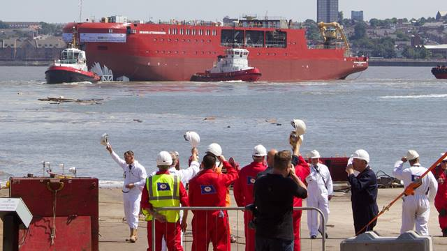 Launch crew salute the RSS Sir David Attenborough ship