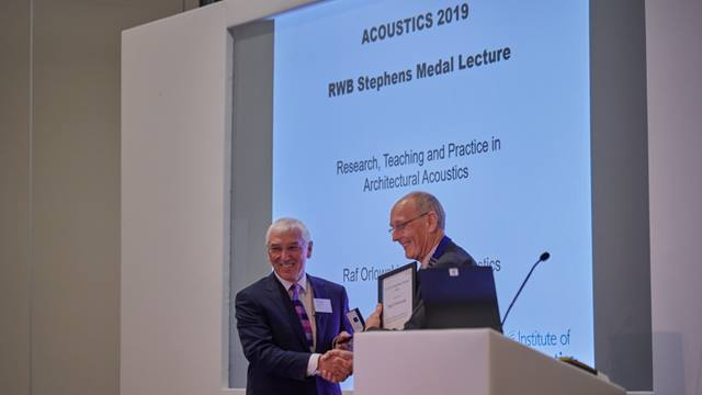 Raf Orlowski collecting the Institute of Acoustics RWB Stephens Medal. Image courtesy of IOA