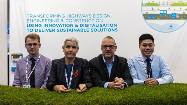 Ramboll at Highways UK 2019 with a stand covered in real grass turf! (L to R): Alistair Brown, Mary Wellman, Jon Harding, Victor LI. © Vicki Sharp Photography