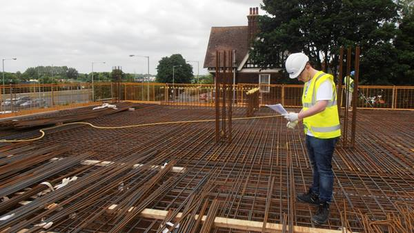 Dan Cornick, on site checking reinforcement to ensure correct installation prior to the concrete pour of the floor slab.